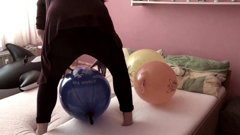 Girl Sit to pop Big Balloons
