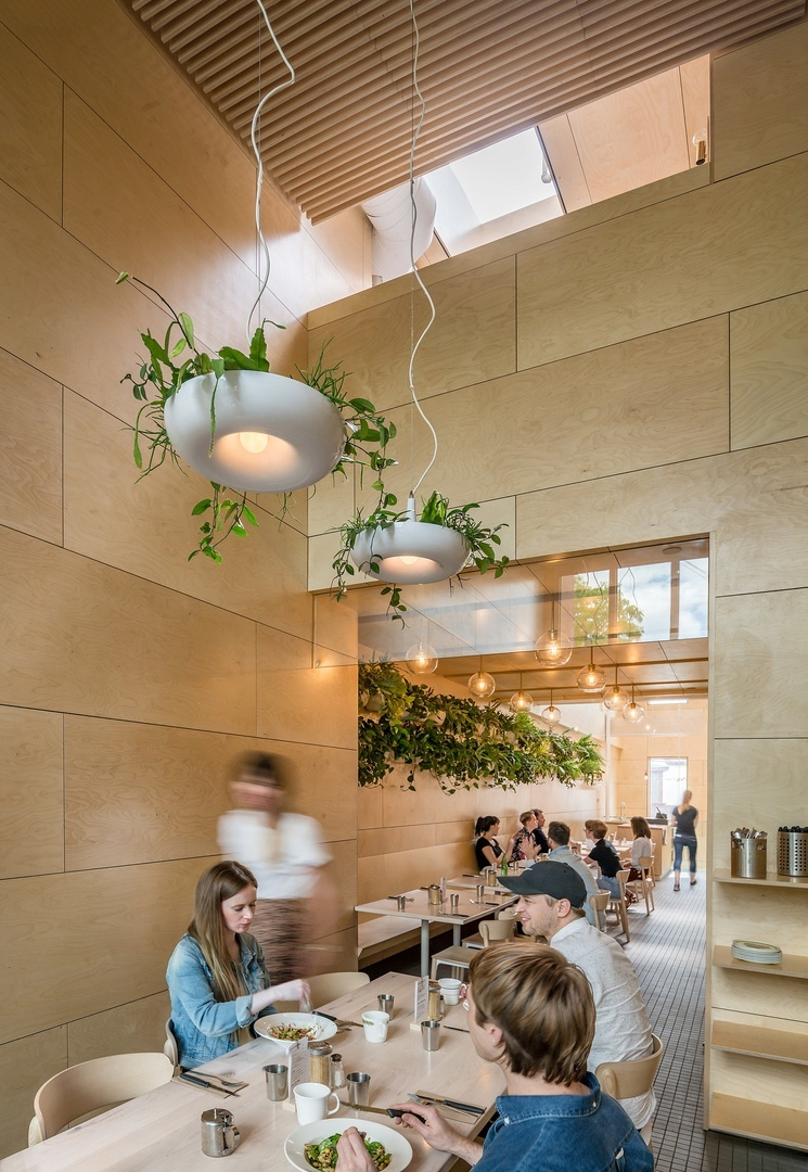 Omar Gandhi brightens Lady Marmalade eatery in Toronto with skylights and baltic wood
