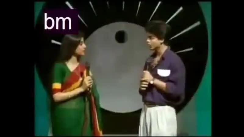 Shah Rukh Khan as a tv anchor in a singing show of Doordarshan