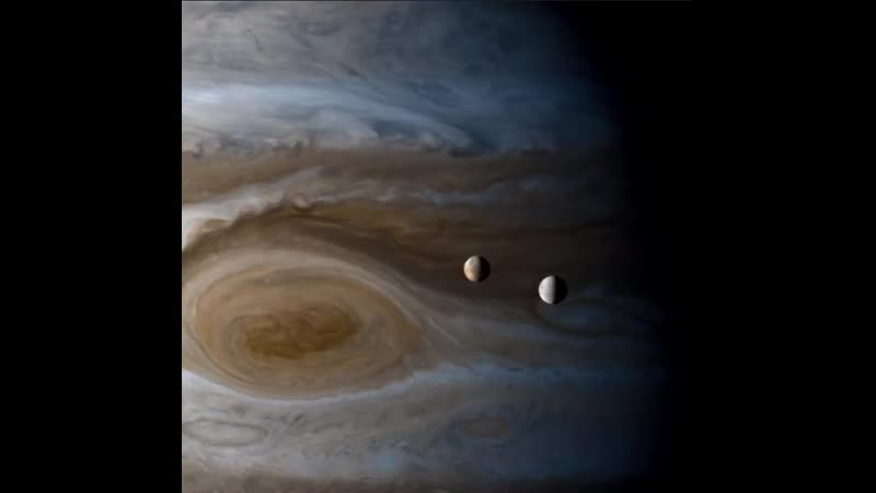 Shown is Io and Europa over Jupiter's Great Red Spot and then Titan as it passes over Saturn