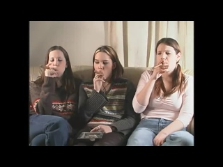 Three young and cute girls smoking cigars.