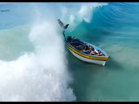 Cape Verde Harbor Fishing boat is capsized by a big wave