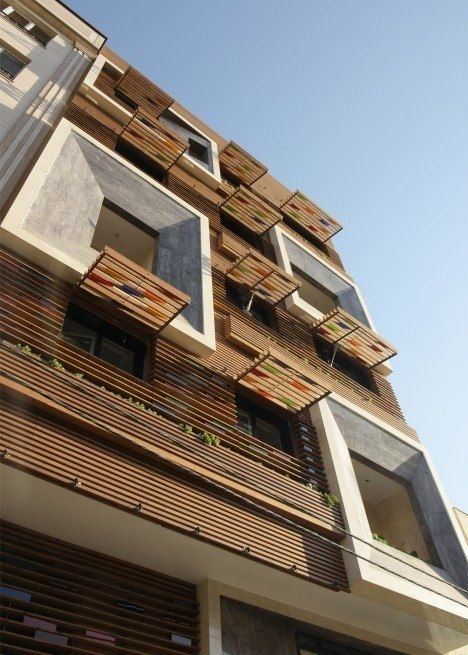 Tehran apartment block by Keivani Architects features faceted window frames and stained glass